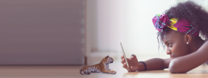 Girl playing with AR tiger